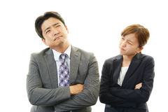 Disappointed businessman and businesswoman Stock Image