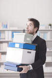 Disappointed businessman carrying boxes Stock Images