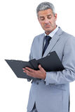 Disappointed businessman holding clipboard Royalty Free Stock Image