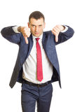 Disappointed businessman with thumbs down Stock Photography