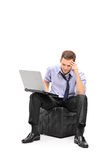 A disappointed businessman working on his laptop Royalty Free Stock Images