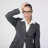 Disappointed businesswoman. A pretty young businesswoman touching her head  with a very disappointed expression on face Royalty Free Stock Image