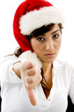 Disappointed businesswoman in christmas hat Stock Image