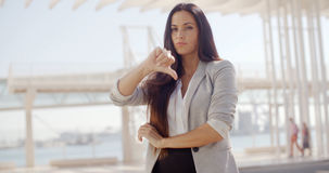 Disappointed businesswoman giving a thumbs down Stock Images