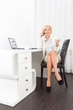 Disappointed businesswoman problem call. Sitting modern office desk, sad business woman using phone negative emotion unhappy talking cellphone Stock Photo