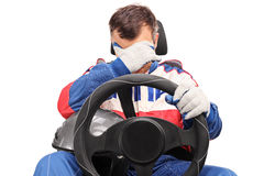 Disappointed car racer looking down Royalty Free Stock Image