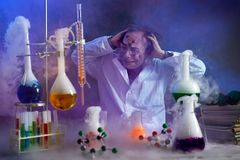 Disappointed chemist looking in his failed experiment. In smoke of explosion Stock Photography
