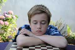 Disappointed chess player Royalty Free Stock Photo