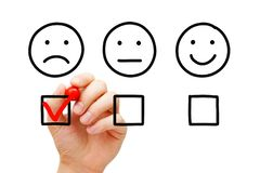 Negative Customer Feedback Survey Concept. Disappointed client leaving negative evaluation with red marker check mark on customer feedback survey. Unhappy drawn stock photos