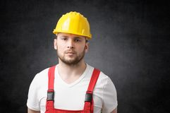 Disappointed construction worker. Unhappy construction worker with yellow hard hat Royalty Free Stock Photo