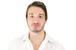 Disappointed or disgusted young man Stock Images