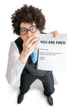 Disappointed employee is showing paper with You are fired message Stock Image