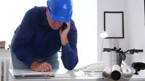 Disappointed Engineer in Office Room Dial a Phone Number Using a Cellphone.  stock video footage