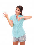 Disappointed female in short jeans with thumb down Royalty Free Stock Photography