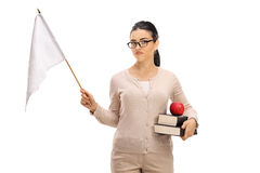 Disappointed female teacher holding a white flag stock photography