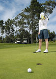 Disappointed Golfer On Putting Green Royalty Free Stock Photos
