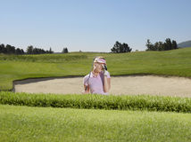 Disappointed Golfer In Sand Trap Royalty Free Stock Photography