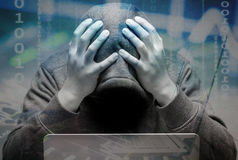 Disappointed hacker. With computer notebook Stock Photography