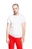 Disappointed handsome man in white t-shirt isolated on white Stock Photos