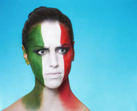 Disappointed italian supporter for FIFA 2014 looking aside Royalty Free Stock Images