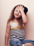 Disappointed kid girl thinking with hand on the head. Portrait Stock Images