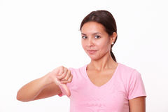 Disappointed latin girl with thumb down Royalty Free Stock Photos
