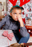 Disappointed little boy at Christmas Royalty Free Stock Photos