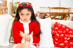 Disappointed little girl wearing christmas dress Royalty Free Stock Photography