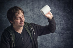 Disappointed Man Looking at Empty Cup Stock Image