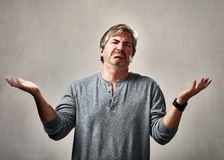 Disappointed man. Disappointed mature man over gray wall background Royalty Free Stock Photography