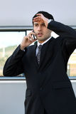 Disappointed man on the phone Stock Photos
