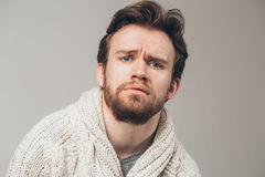 Disappointed man portrait beard stock image