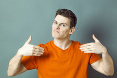 Disappointed man showing himself with hands for low self-esteem Stock Images