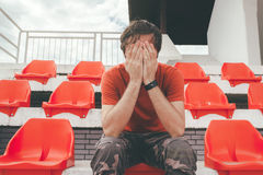 Disappointed man at sport stadium watching the game Royalty Free Stock Image