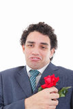 Disappointed man in suit with weird geeky face expression  showi Stock Photo