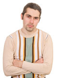 Disappointed man in sweater isolated. Young dark haired caucasian man in striped sweater looking sadly isolated on white Stock Photos