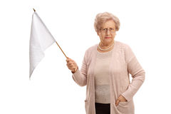 Disappointed mature woman holding a white flag Royalty Free Stock Photography