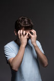 Disappointed men. Portrait of sad men covering his face with han Stock Image