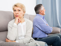Disappointed middle-aged couple quarreling at home with each oth Royalty Free Stock Images