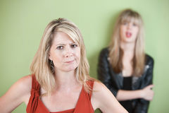 Disappointed Mom. Angry mom with daughter in the background Stock Photography
