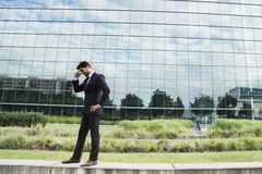 Successful businessman or worker standing in suit near office building Royalty Free Stock Photography