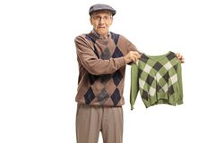 Disappointed senior holding a shrunken blouse royalty free stock photography
