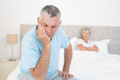 Disappointed senior man with woman in background Stock Images