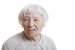 Disappointed senior woman. Senior woman studio portrait disappointed (Mouth lips side Royalty Free Stock Photo