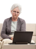 Disappointed senior women with notebook internet problem Royalty Free Stock Photos