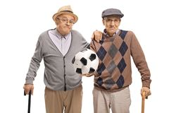 Disappointed seniors holding a deflated football Stock Photos
