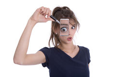 Disappointed shocked isolated woman holding magnifying glasses. Stock Photo