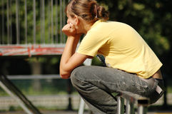 Disappointed skate girl in park Royalty Free Stock Image