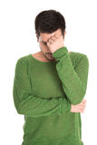 Disappointed student with green pullover isolated on white backg Royalty Free Stock Images