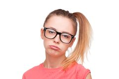 Disappointed teen girl in glasses Stock Photos